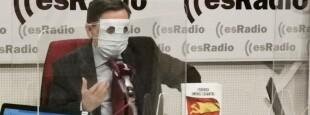 Sur une chaîne de télévision, le journaliste de droite Federico Jiménez Losantos annonce le vote des «pro ETArra» EHBildu en faveur du budget espagnol, le visage recouvert d'une cagoule, symbole des communiqués audiovisuels d'Euskadi Ta Askatasuna.